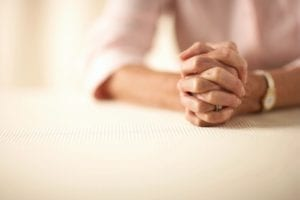 A Close Up image of a women's hands as she prays.